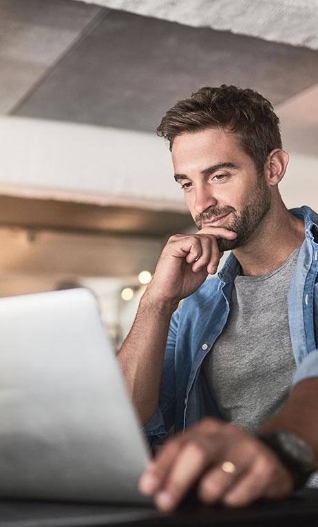 Financial – Man checking his prepaid card balance online.
