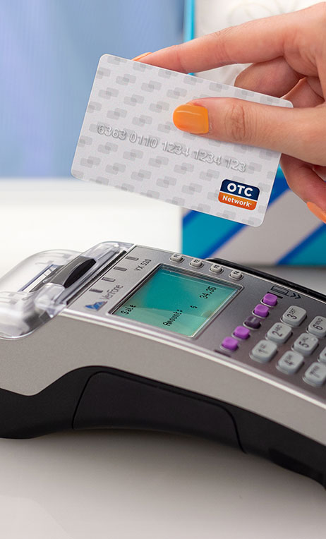 InComm – Image of a woman swiping an OTC Supplemental Benefit card on a point-of-sale system.