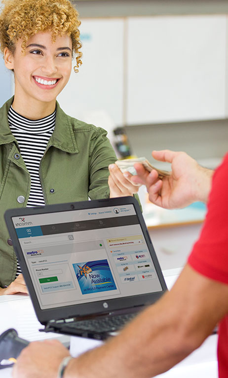 Agent Solutions – Image of a woman paying for a bill inside a wireless store.