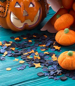 Fintech Insights – Halloween carved pumpkin and decorations on a blue table.