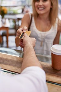 Incentives – Woman buying coffee with a physical gift card.