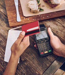 Fintech Insights – Customer paying for meal with an open–loop gift card.