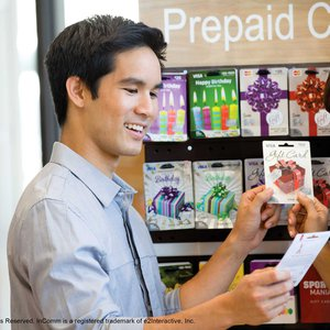 Couple selecting prepaid gift cards
