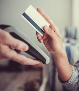 Fintech Insights – Woman ready to swipe her gift card in point of sale system.